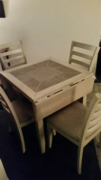 rectangular brown wooden table with chairs Longueuil, J4K 2W6