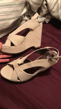pair of gray peep-toe slingback wedge sandals