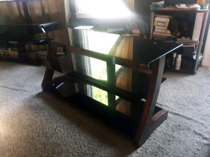 3 tier glass entertainment center. Like new. 1