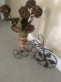 black wrought iron bike with petaled flower