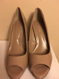 pair of women's nude colored Aldo open toe pumps