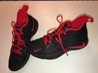 pair of black-and-red Nike basketball shoes 446 mi