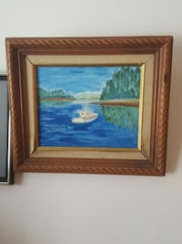 brown wooden framed painting of boat