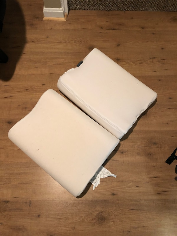 Two foam pillows with curve for neck support  d6e471d6-f860-4b8f-bda0-e7e753af4e80