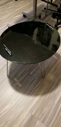Lacquer table with handles and metal legs. In excellent condition.