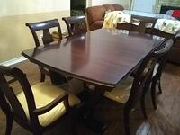 rectangular brown wooden table with six chairs dining set Houston, 77067