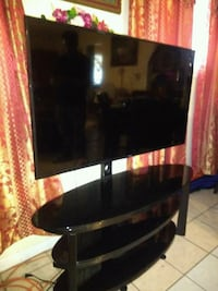 black flat screen TV with black wooden TV stand Corpus Christi, 78412