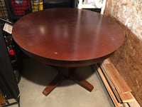 Round brown wooden pedestal table 363 mi