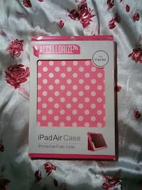 white and pink polka dotted ipad air case in box