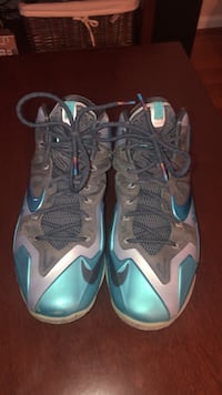 pair of gray-and-teal Nike basketball shoes Bristow, 20136