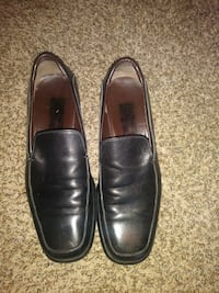 pair of black leather penny loafers Dallas, 75232