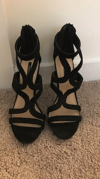 pair of black peep toe ankle strap pumps