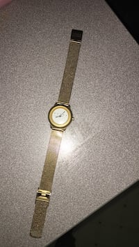 round gold analog watch with gold link bracelet St Catharines, L2M 3K6