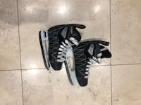 pair of black-and-white Nike cleats 550 km
