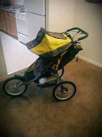 baby's black and yellow jogging stroller Temple Hills