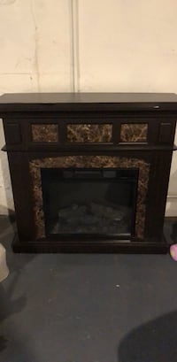 black and brown electric fireplace Garfield, 07026