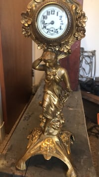 Brown and white ceramic figurine I know this clock is worth every penny of this if this clock went to auction it could bring up to $1000-$1500 I don't have time I have to sell house and leave state Owings Mills, 21117