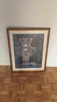 black and white pot painting with brown wooden frame