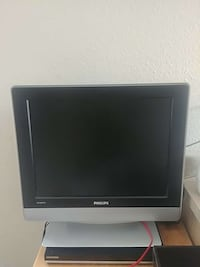 black and gray philips flat screen TV