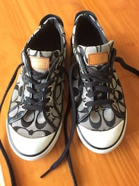 Pair of gray-and-black coach sneakers