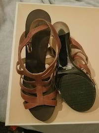 pair of brown leather ankle-strap open-toe heeled sandals with box