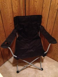 A black camp chair with carry case