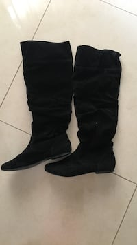 pair of black suede slouchy flat high-top boots