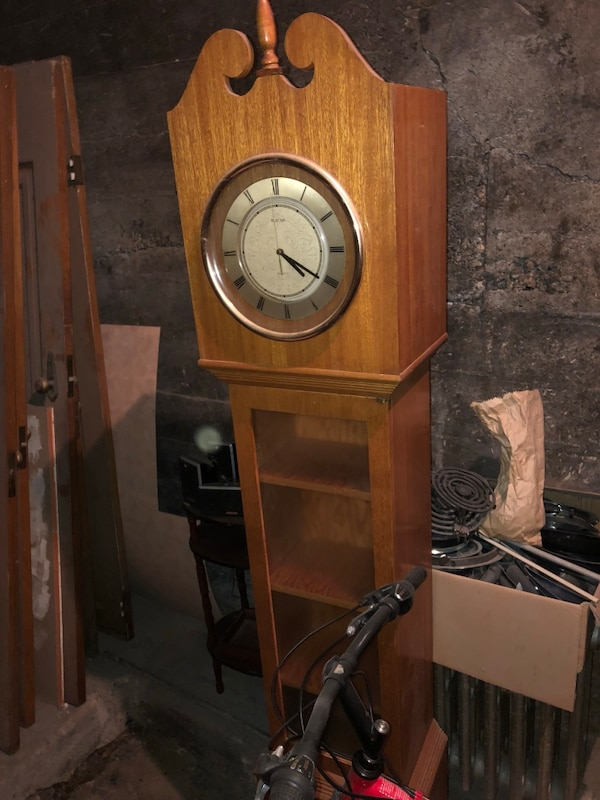 brown wooden framed pendulum clock