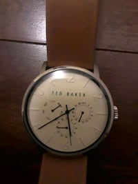 round silver analog watch with brown leather strap Calgary, T3H