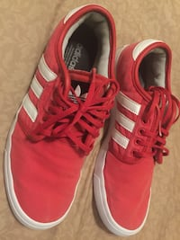 Pair of red adidas low-top sneakers Bakersfield, 93307