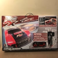 Real FX Racing: Slotless Racetrack System including two RC Cars and Handsets. Falls Church, 22041