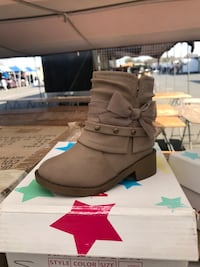 unpaired brown side-zip ankle-strap boot with box