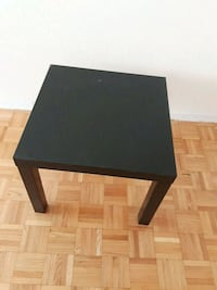 rectangular black or white wooden coffee table