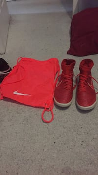 Red pair of indoor Nike soccer shoes Calgary, T3J 4V2