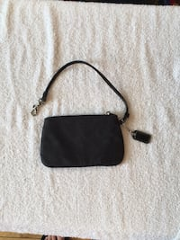 Black Coach wristlet. 6 inches L 4inches H. Rarely used Arlington, 22206