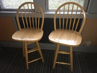 Two brown wooden windsor chairs 601 mi