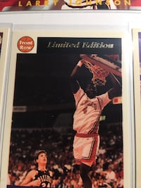 Larry Johnson cards with him in UNLV uniform
