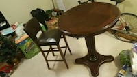 round brown wooden pedestal table North Vancouver, V7M