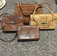 brown leather tote bag and wristlet