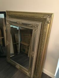 Brown wooden framed wall mirror North Vancouver, V7J 1E6