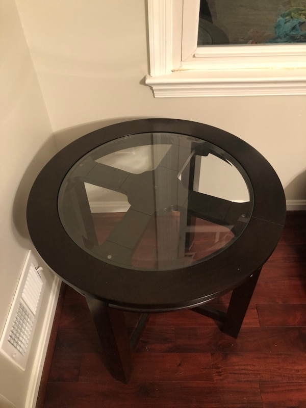 Glass top wood end tables. It's a set of two. In great condition