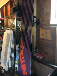 Purple and black snowboard deck