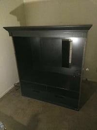 black wooden TV stand must be picked up tonight