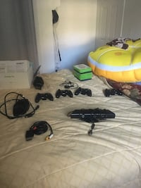 Black xbox 360 kinect with four controllers, 9 games, and ear piece