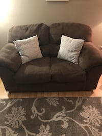 Cozy clean love seat and tv