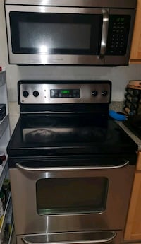 Brand new oven with stove and microwave set
