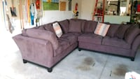brown suede sectional couch with throw pillows