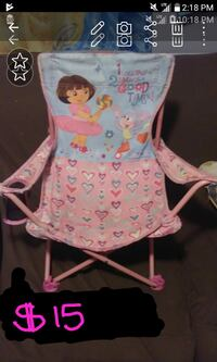 $15. Dora with boots pink chair. Laredo, 78040