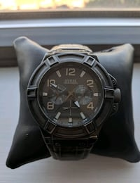 Guess watch with a genuine leather strap Mississauga, L4Z 1S3