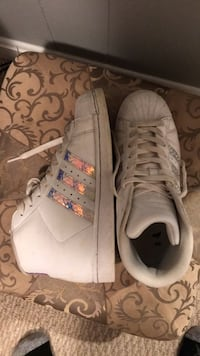 pair of white low-top sneakers 32 km